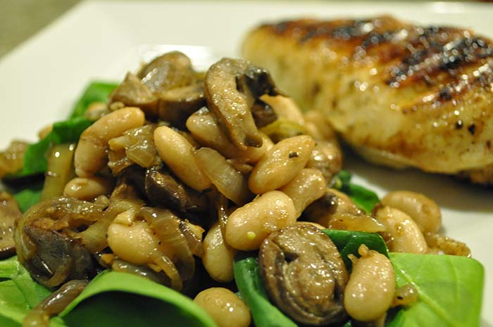 Spinach salad with caramelized onions, mushrooms, and cannellini beans? Or pile of mush on a bed of lettuce?