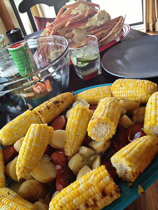 """Matt and Danielle served mojitos, crab legs, and a medley of cobbed corn, potatoes, and sausage. This is one invitation we definitely did not want to say """"no"""" to."""